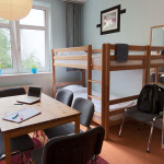 8 bed dorm room with locker